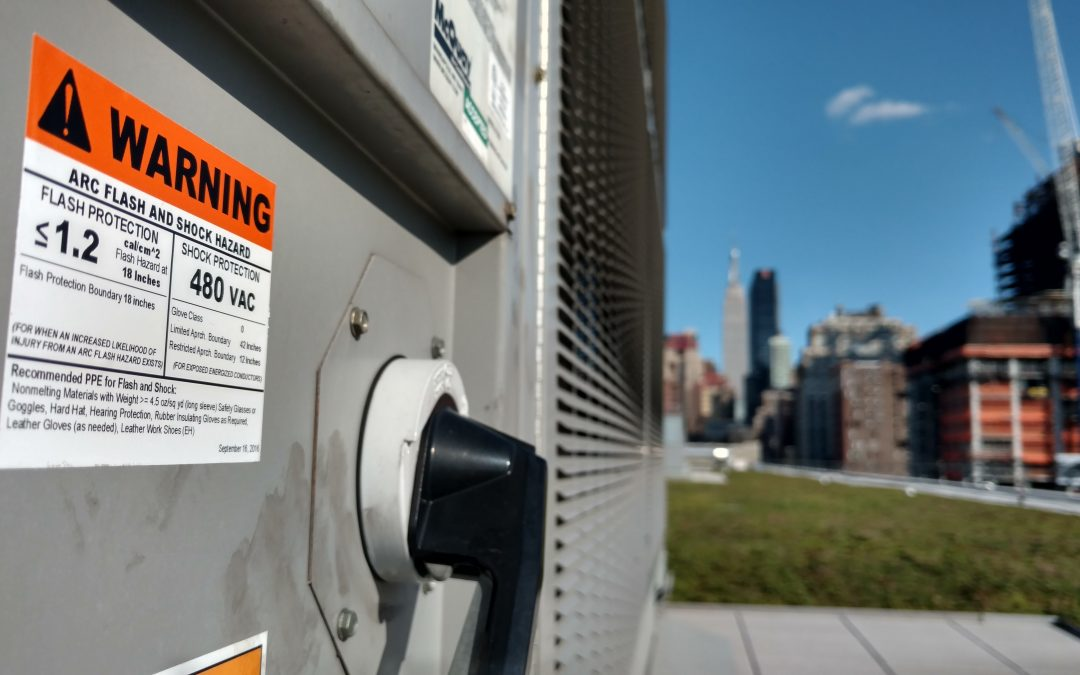 Where should an electrical hazard label be placed on a piece of equipment?
